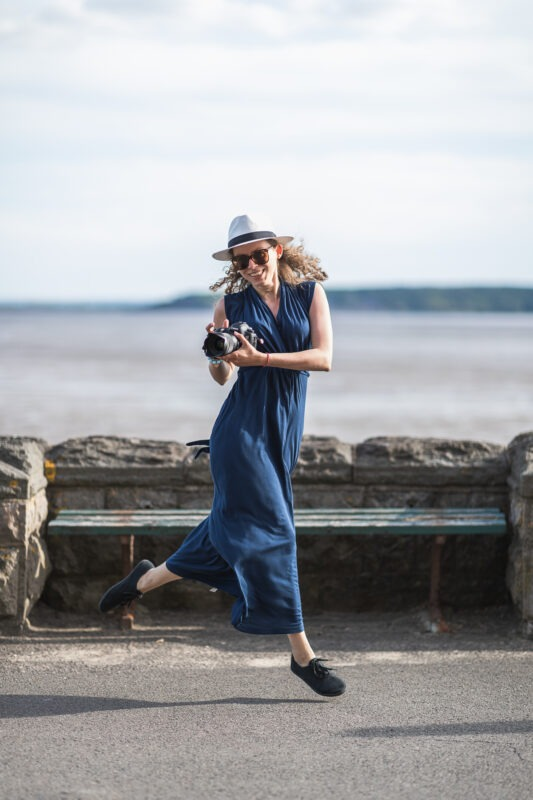Ewa Kara - Richmond upon Thames Brand and lifestyle photographer - jumping with a camera in her hands